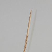 Gravur auf einem Zahnstocher